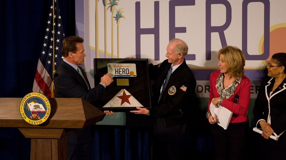 "Governor Arnold Schwarzenegger and First Lady Maria Shriver host a celebration honoring US Airways Captain Chesley ""Sully"" Sullenberger, recognizing his heroism in safely landing flight 1549 in the Hudson River after losing power in both engines, then risking his own life to ensure all passengers were out of the plane."